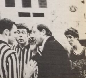Coach Goodnight discusses officiating as Sabo looks on vs East Gary